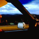 Grover Marks drives his Cadillac towards Spokane, Washington.
